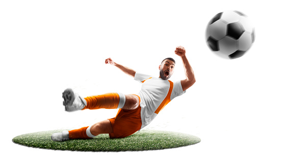 A soccer player kicks the ball. Isoalted. Sport