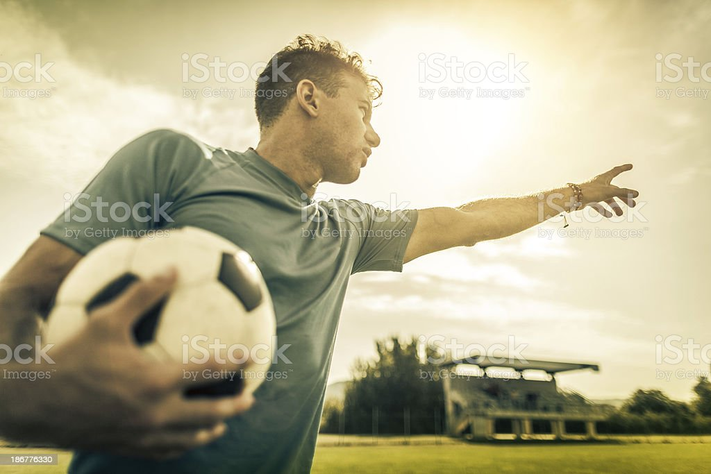 Soccer player leader on the football pitch royalty-free stock photo