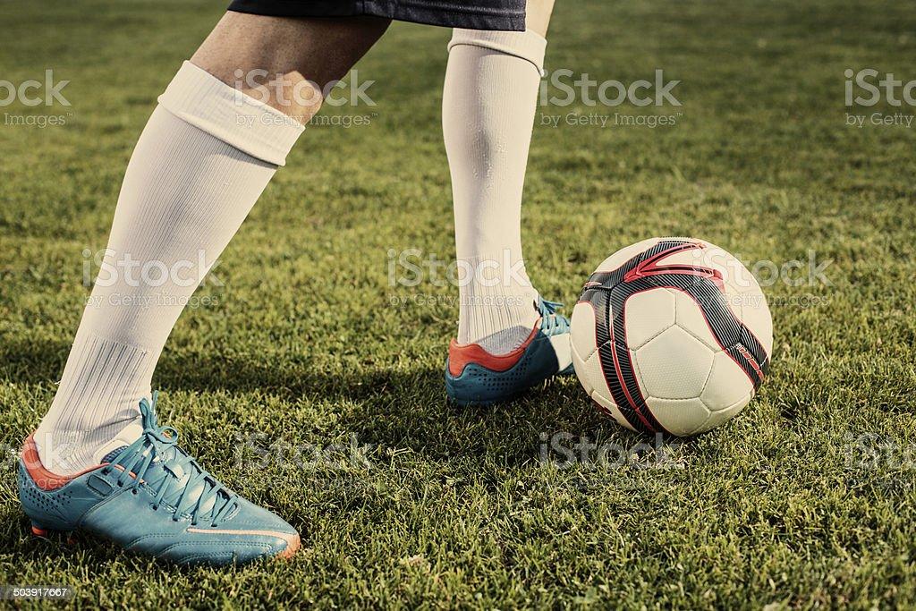 Soccer player makes tricks stock photo