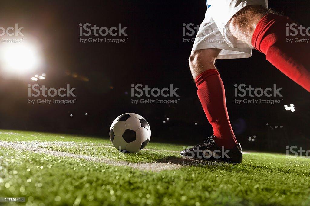 Soccer player making a corner kick stock photo