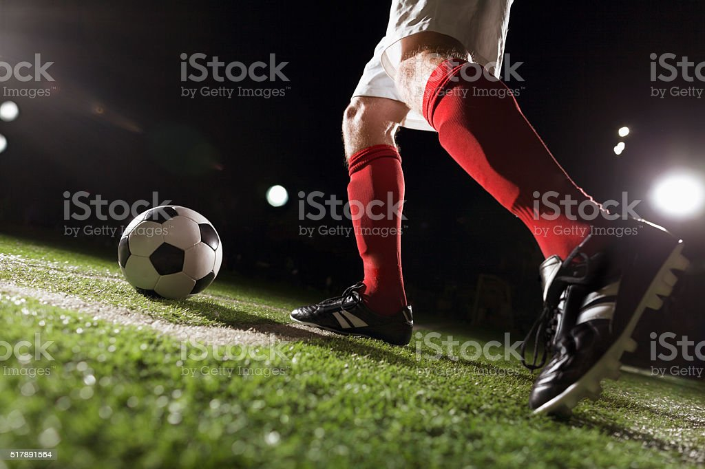 Soccer player making a corner kick stock photo