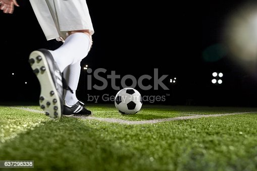 637298374istockphoto Soccer player making a corner kick 637298338