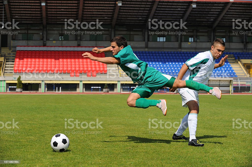 Soccer player making foul stock photo