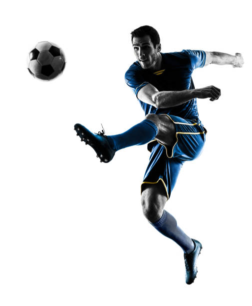 soccer player man kicking silhouette isolated stock photo