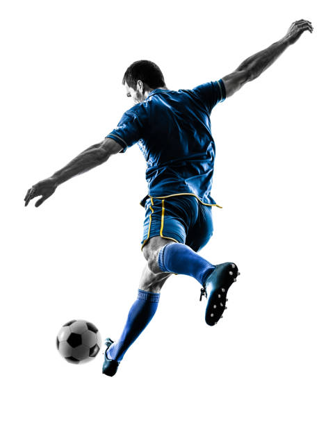 soccer player man kicking silhouette isolated - soccer player stock photos and pictures