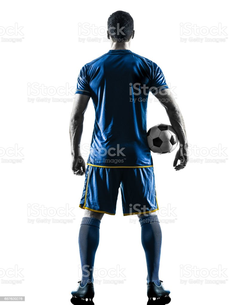 soccer player man standing back  silhouette isolated stock photo