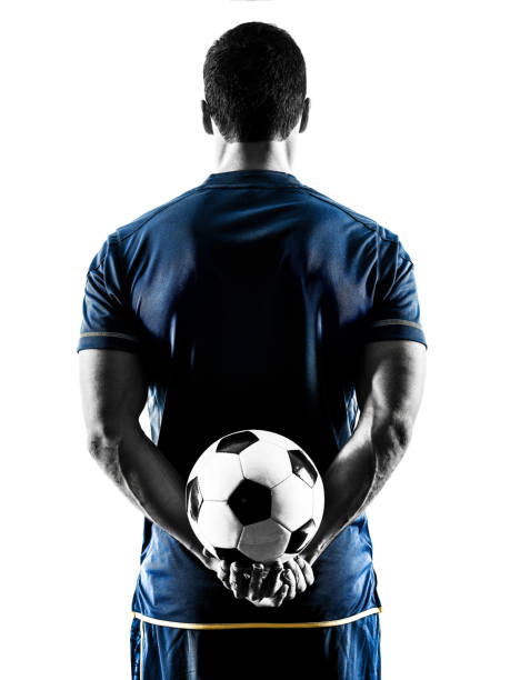 soccer player man standing back  silhouette isolated - soccer player stock photos and pictures