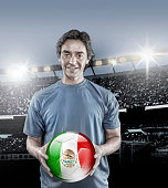 Soccer player Mexico holding ball with mexican flag in stadium