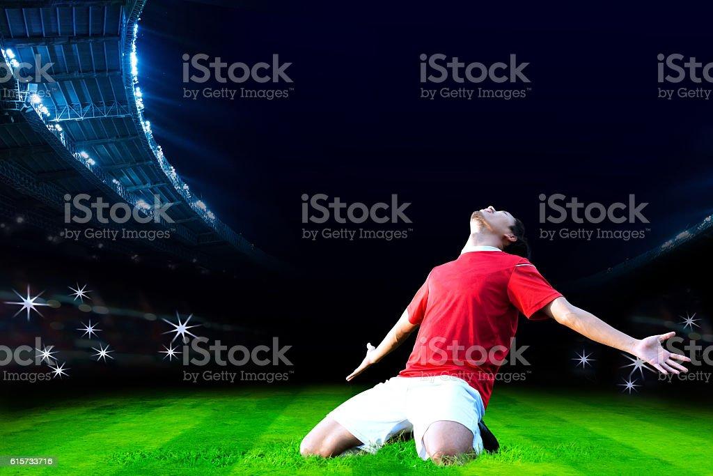 Soccer player on field of stadium – Foto