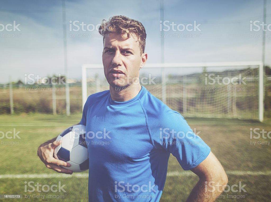 Soccer player on the football pitch royalty-free stock photo