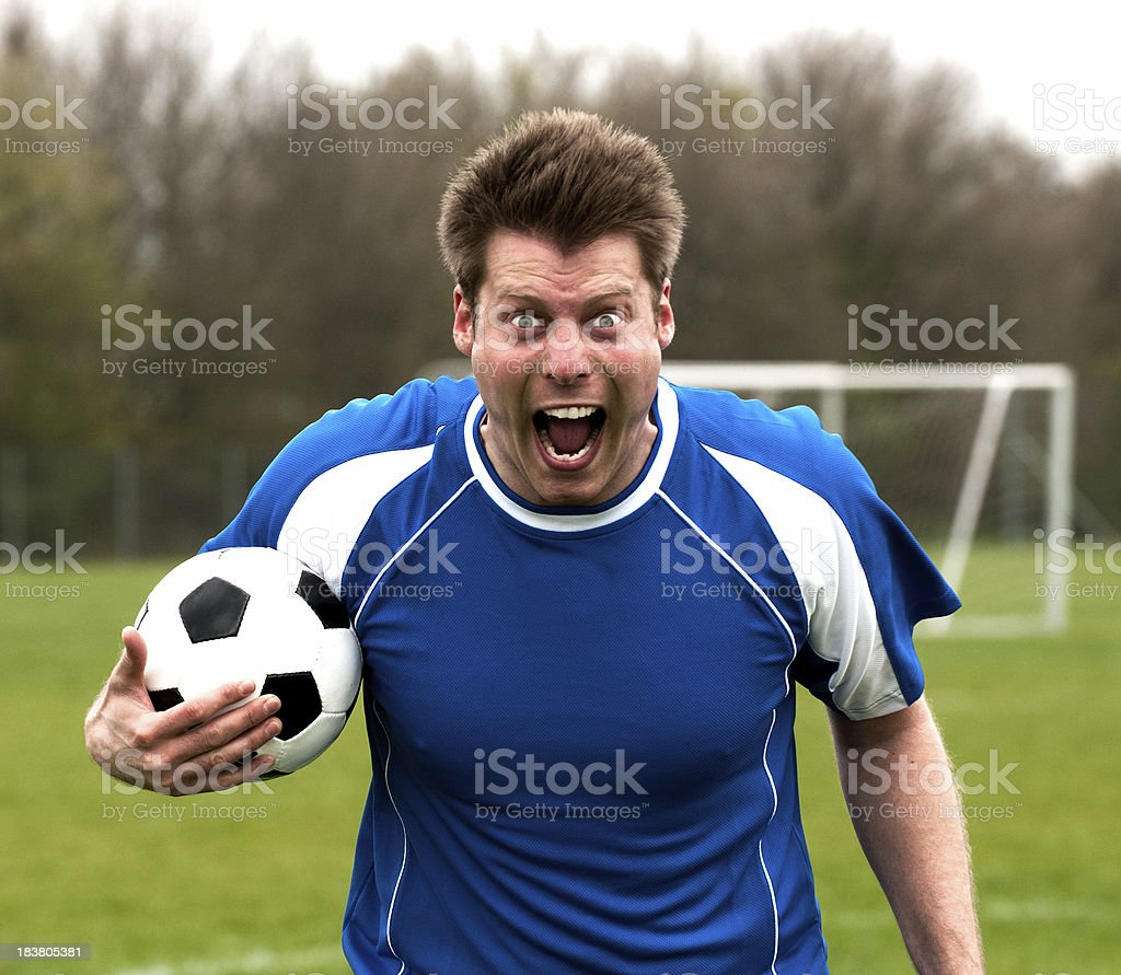 Soccer player out of control and screams royalty-free stock photo