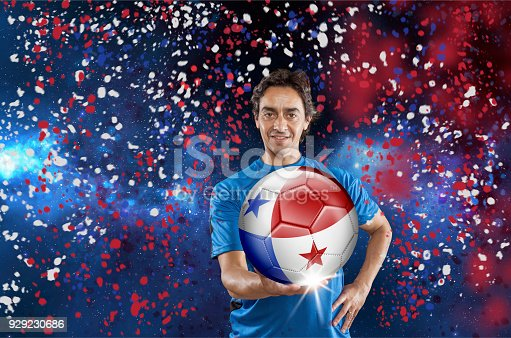 istock Soccer player Panama holding ball with national flag under confetti 929230686