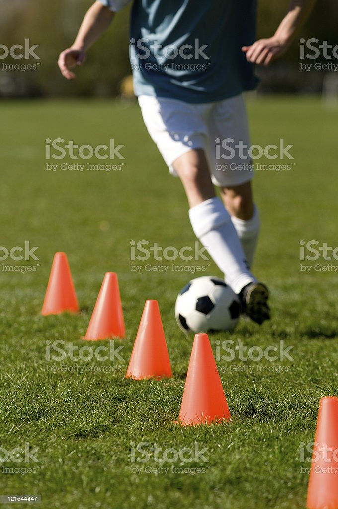Soccer player perfoms training with a football stock photo