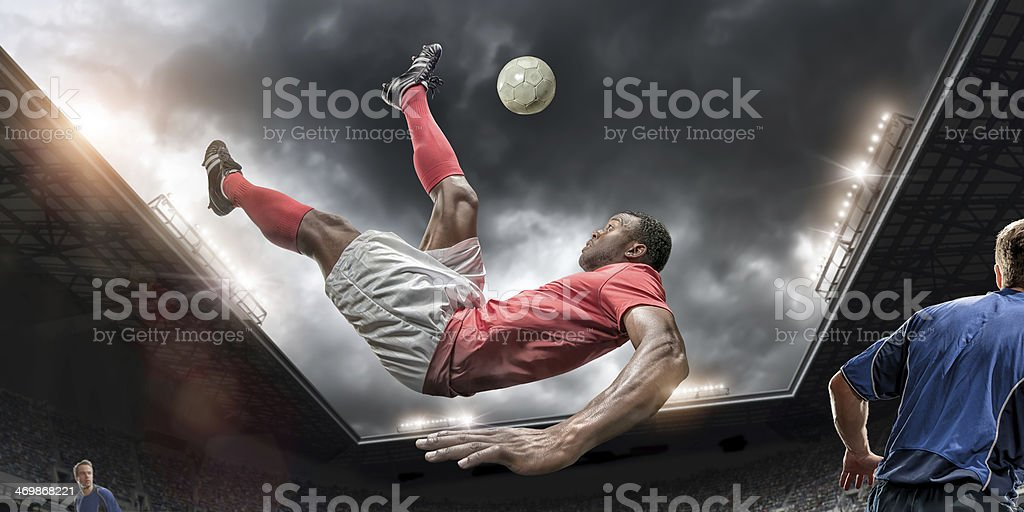 Soccer Player Performing Overhead Kick stock photo