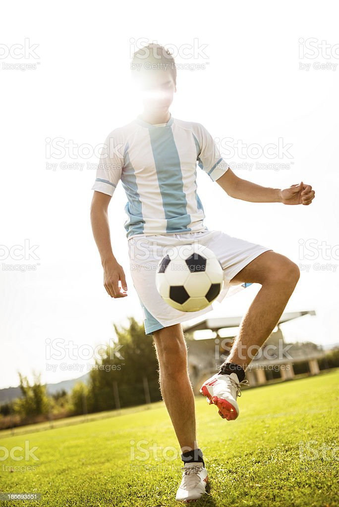 Soccer player playing with ball royalty-free stock photo
