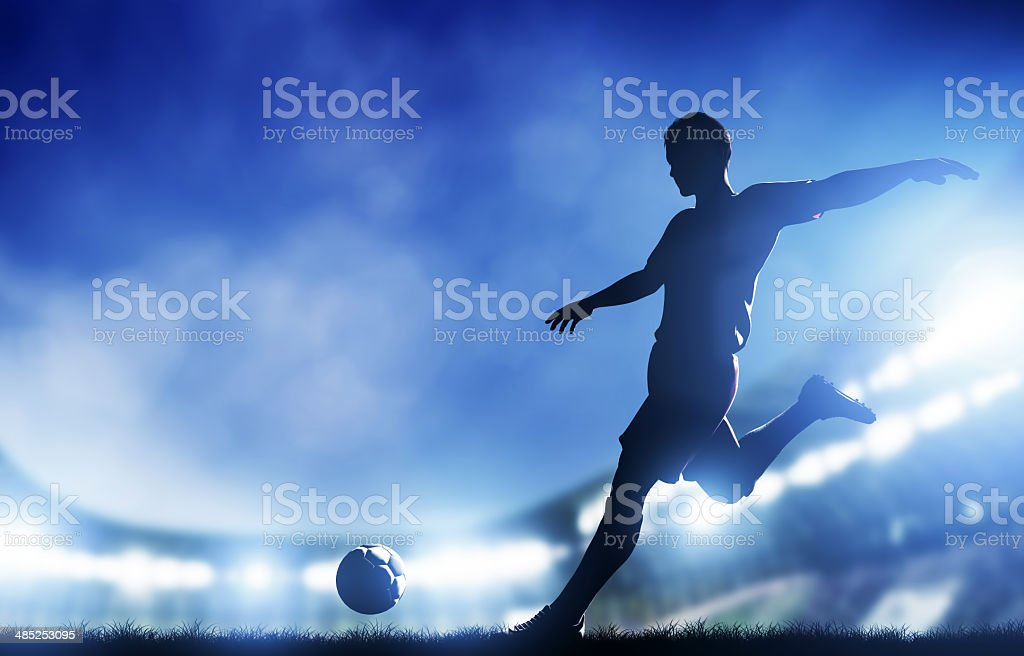 Soccer player prepares to kick ball into goal stock photo