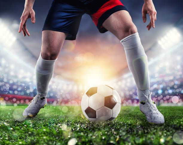 Soccer player ready to kick the soccerball at the stadium during the match stock photo