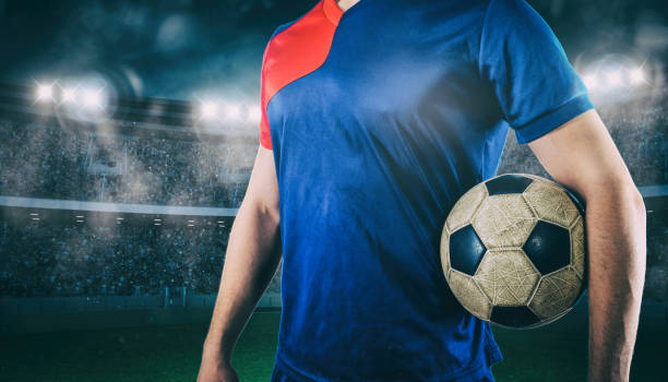 Soccer player ready to play with ball in his hands at the stadium - foto stock