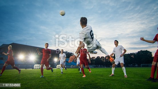 istock Soccer Player Receives Successful Pass and Kicks Ball to Score Amazing Goal doing Bicycle Kick. Shot Made on a Stadium Championship. 1161534865