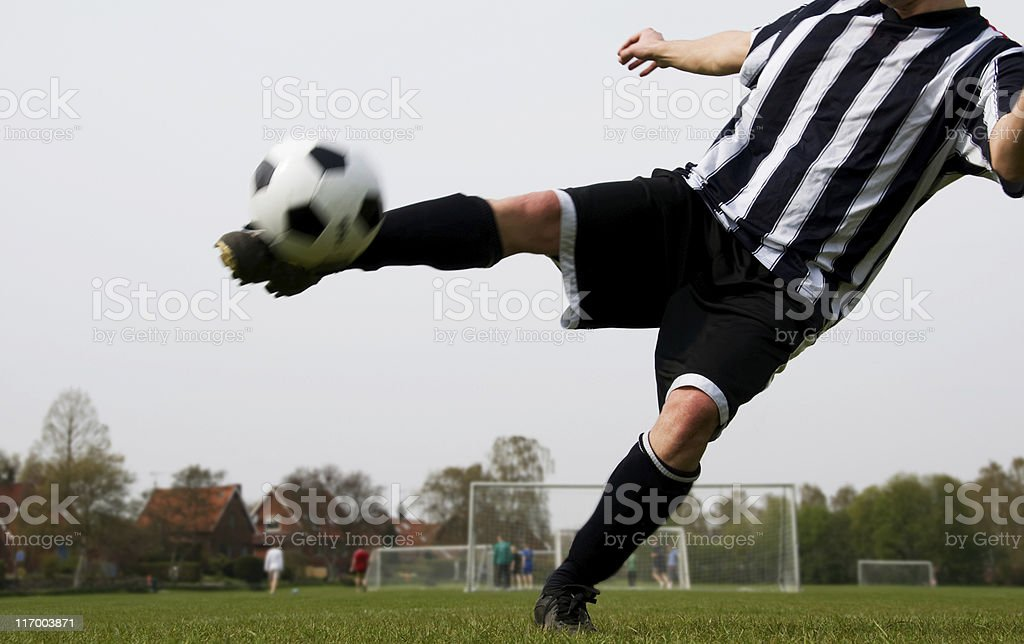 Soccer player shoots at the goal royalty-free stock photo