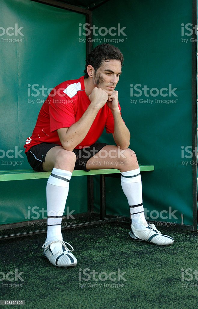Soccer Player Sitting on Sidelines royalty-free stock photo