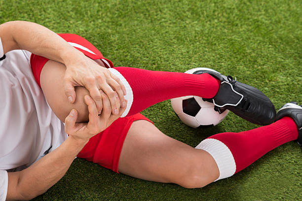 Soccer Player Suffering From Knee Injury stock photo