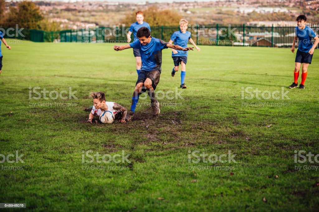 Soccer Player Tackled Down stock photo
