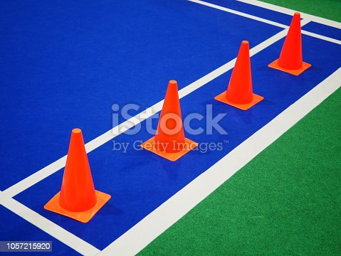 986840244istockphoto Soccer player train on the green grass 1057215920