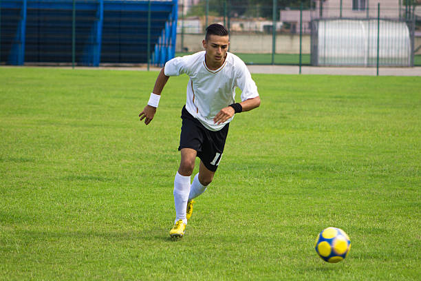 Soccer player using freekick on the soccer field