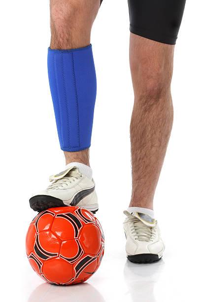 Soccer player wearing a neoprene brace stock photo
