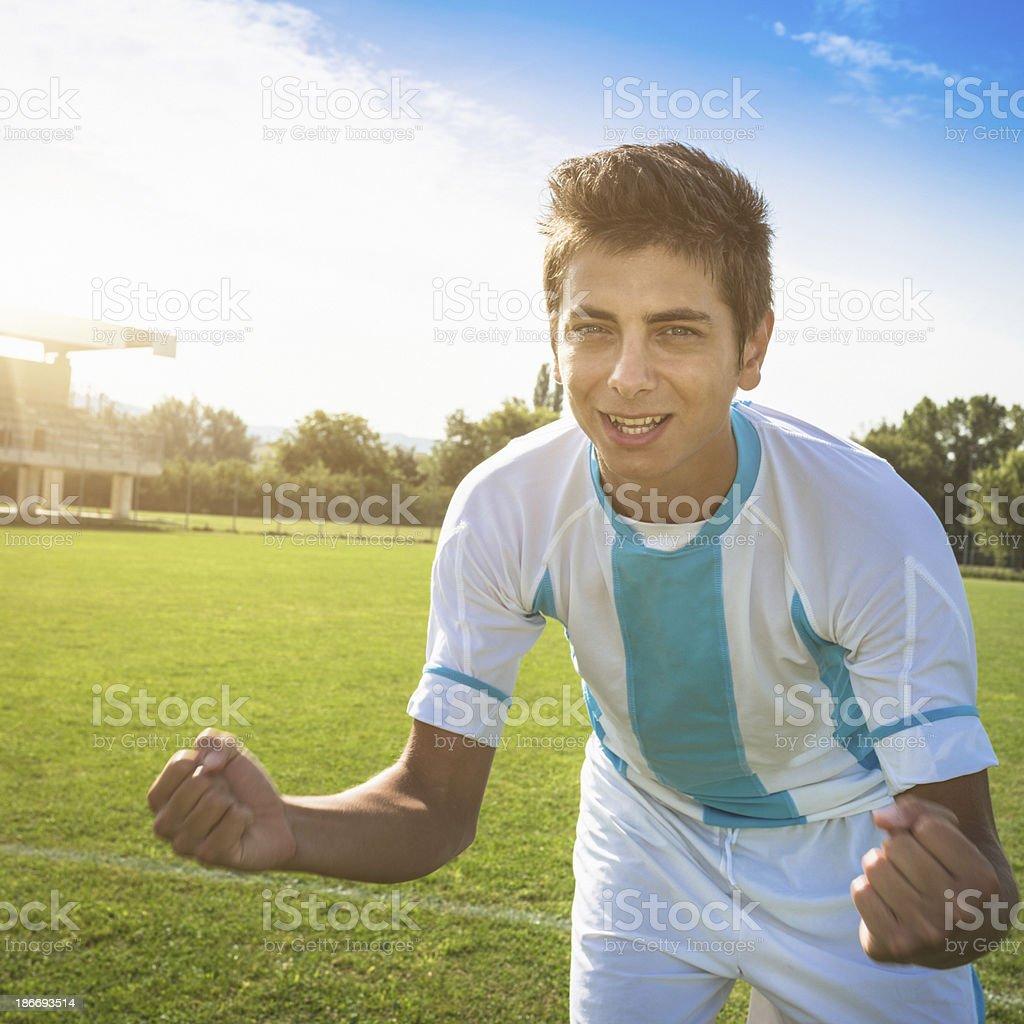 Soccer player winning royalty-free stock photo