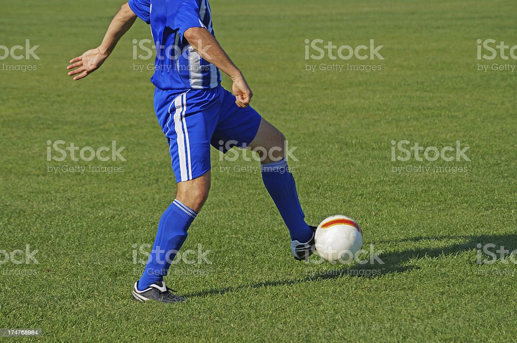 soccer player with a ball royalty-free stock photo