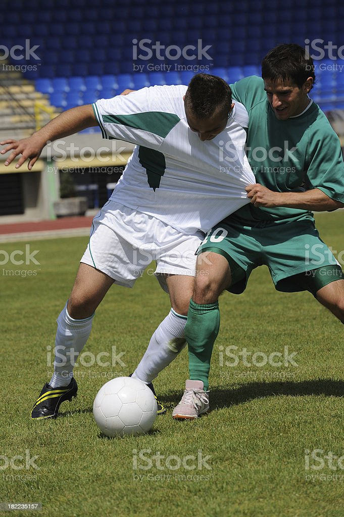 Soccer players at dirty game stock photo