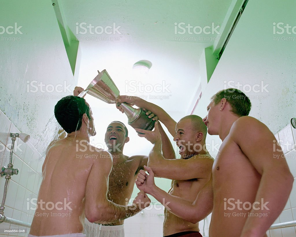 Soccer players celebrating in shower royalty free stockfoto