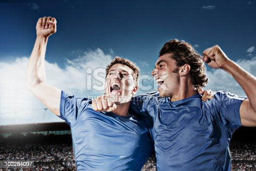 istock Soccer players cheering 102284097