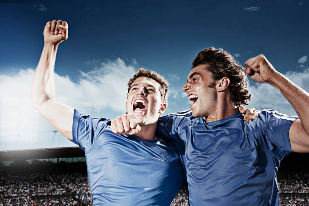Soccer players cheering stock photo