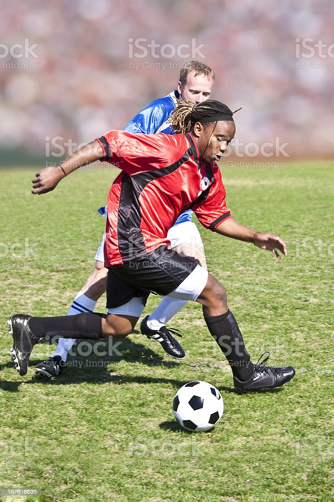 Soccer Players Dribbling the Ball in Professional League Action royalty-free stock photo