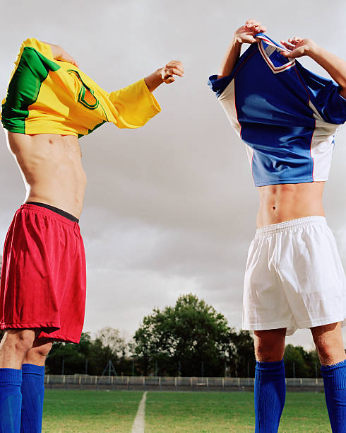 soccer players exchanging t-shirts - sports uniform stock photos and pictures