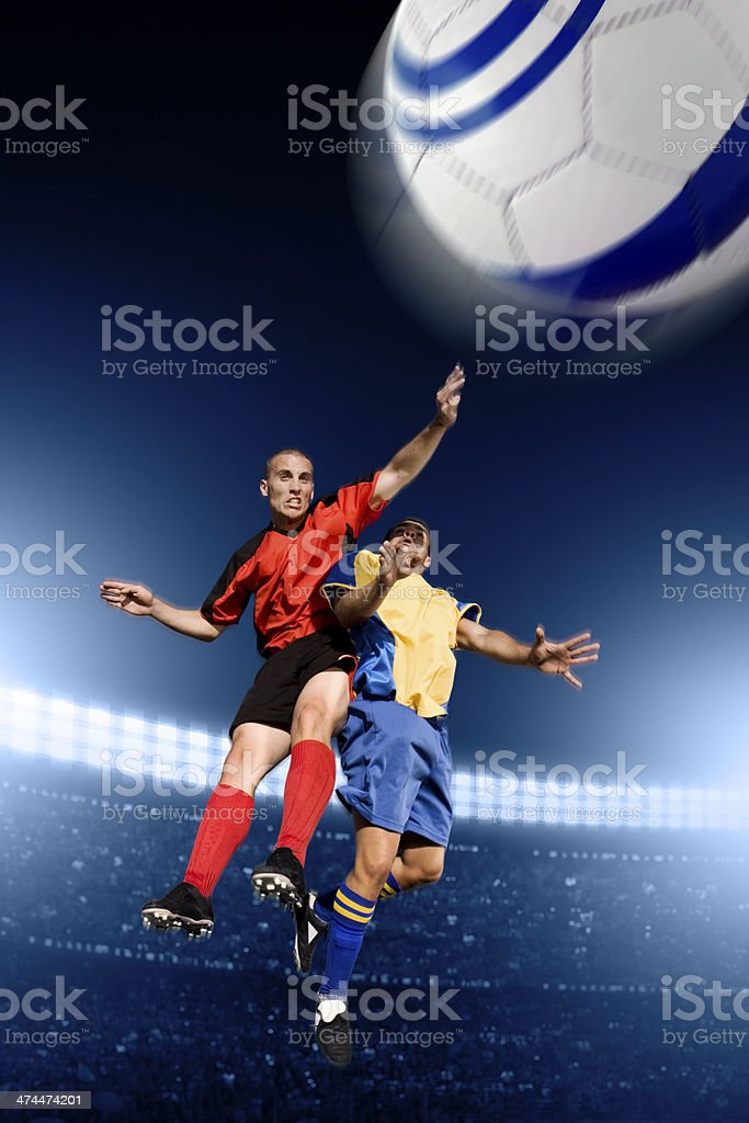 Soccer players fight in the air royalty-free stock photo