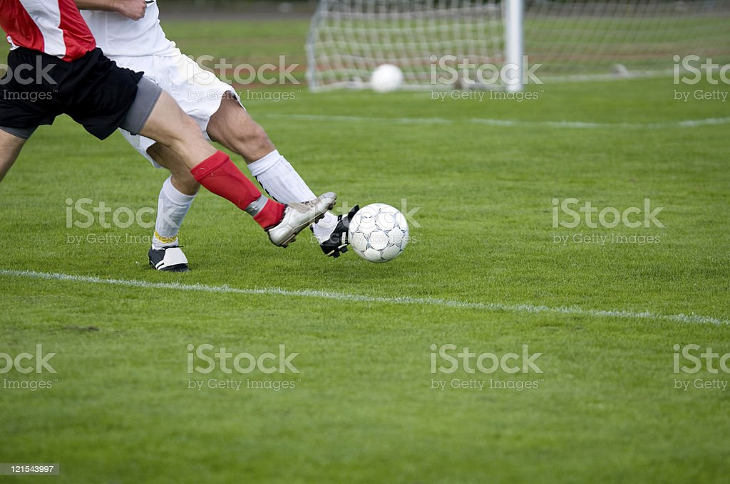 Soccer players fight to take control with ball stock photo