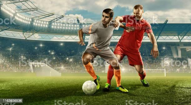 Soccer players fighting for a ball on a stadium picture id1163936536?b=1&k=6&m=1163936536&s=612x612&h=r 1 eel5xnkyojtz4vv7qzejjcm1 jdv3fi wgrc934=