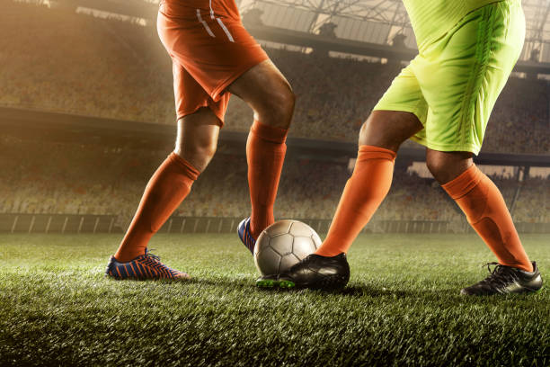 soccer players fighting for a ball - sports championship stock photos and pictures