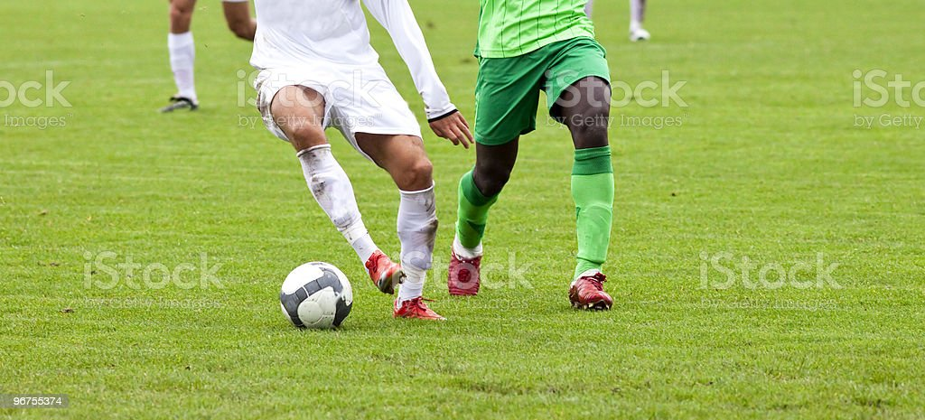 Soccer players fighting for the ball stock photo