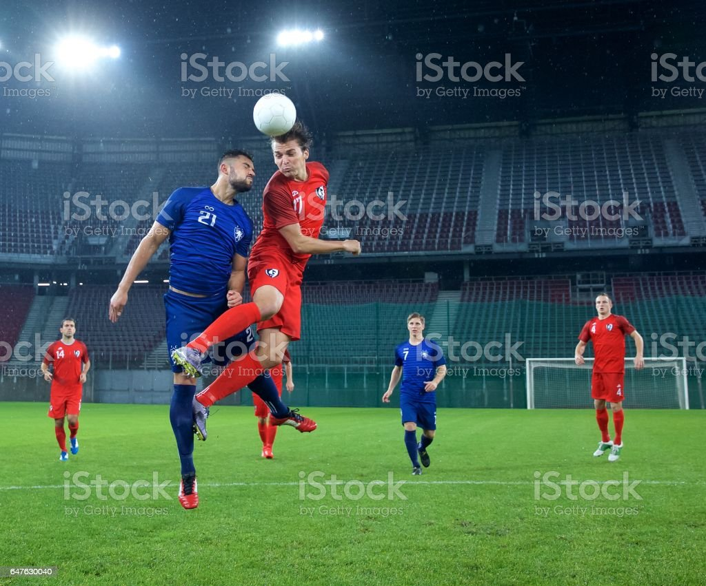 Soccer players heading stock photo