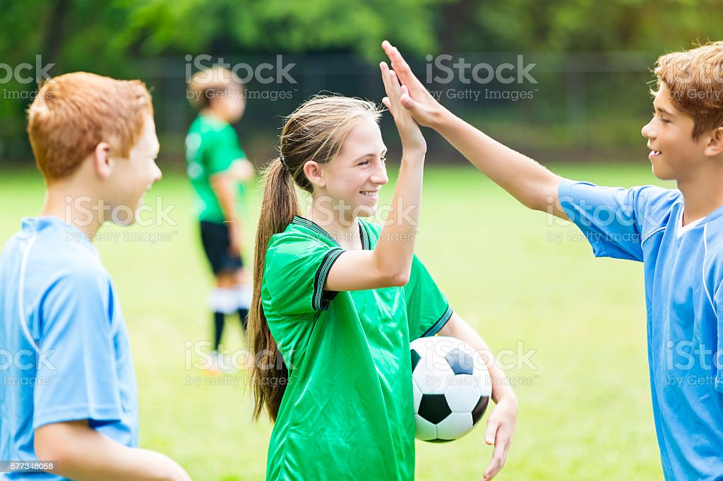 Soccer players high five after game stock photo