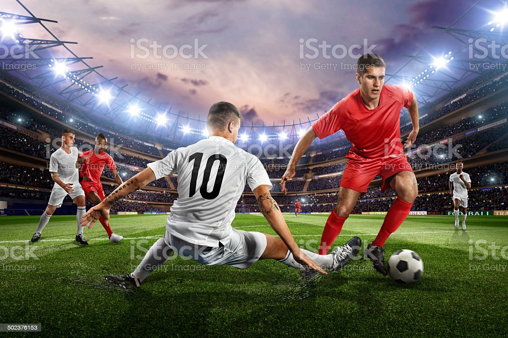 Soccer players in action on soccer stadium stock photo