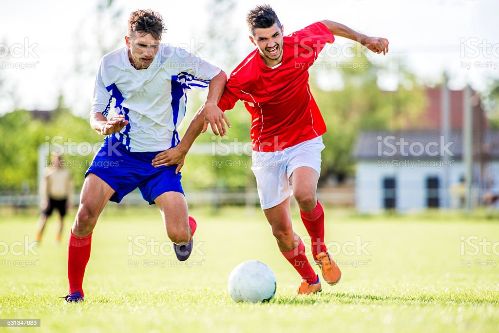 Soccer players in action. stock photo