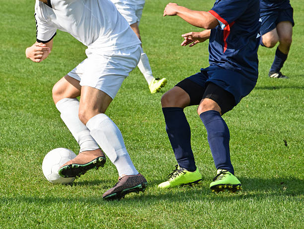 soccer players in action - soccer league stock pictures, royalty-free photos & images