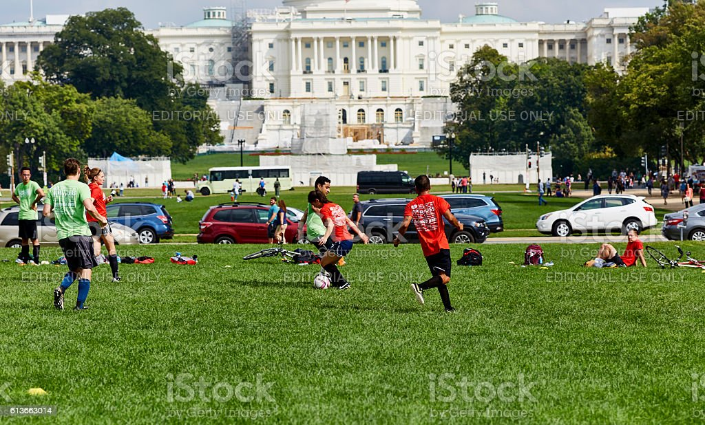 Soccer Players in Park in Front of US Captial Building stock photo