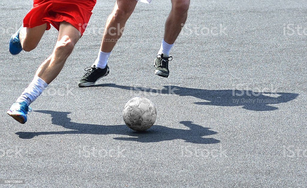 Soccer Players in Sportswear Dribbling the Ball stock photo